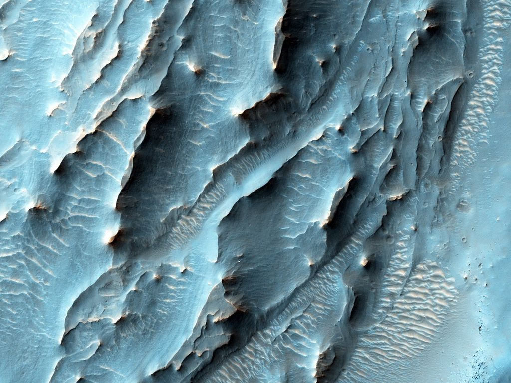 NASA's Mars Reconnaissance Orbiter, nearing the 10th anniversary of its arrival at Mars, used its High Resolution Imaging Science Experiment (HiRISE) camera to obtain this view of an area with unusual texture on the southern floor of Gale Crater.