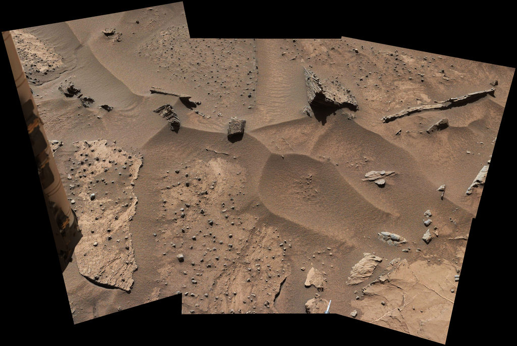Patches of Martian sandstone visible in the lower-left and upper portions of this view from the Mast Camera (Mastcam) of NASA's Curiosity Mars rover have a knobbly texture due to nodules apparently more resistant to erosion than the host rock in which some are still embedded.