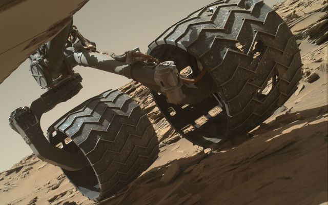 The team operating the Curiosity rover uses a camera on the rover's arm to check the condition of the wheels at routine intervals. This image of Curiosity's left-middle and left-rear wheels is part of an inspection set taken on Curiosity's 1,179th Martian day, or sol, on Mars.