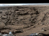 "This 360-degree panorama from the Mastcam on NASA's Curiosity Mars rover shows the rugged surface of ""Naukluft Plateau"" plus upper Mount Sharp at right and part of the rim of Gale Crater. The April 4, 2016, scene is dominated by eroded remnants of a finely layered ancient sandstone deposit."