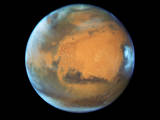 read the article 'Hubble Takes Mars Portrait Near Close Approach'