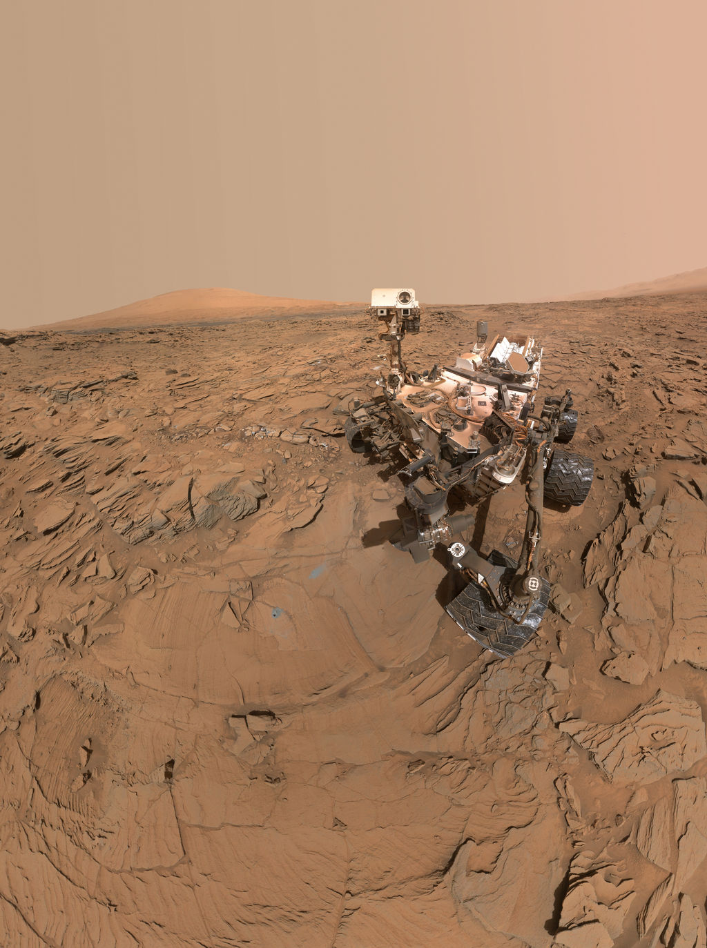 "This May 11, 2016, self-portrait of NASA's Curiosity Mars rover shows the vehicle at the ""Okoruso"" drilling site on lower Mount Sharp's ""Naukluft Plateau."" The scene is a mosaic of multiple images taken with the arm-mounted Mars Hands Lens Imager (MAHLI)."