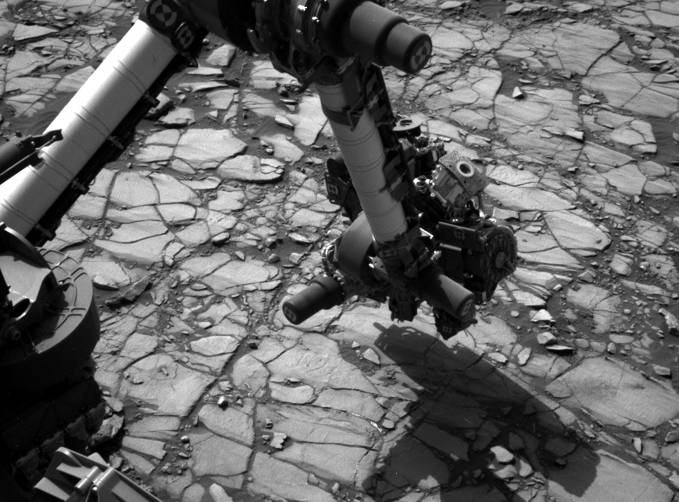 "NASA's Curiosity Mars rover began close-up investigation of a target called ""Marimba,"" on lower Mount Sharp, during the week preceding the fourth anniversary of the mission's Aug. 6, 2016, landing. Curiosity's Navigation Camera took this shot of the rover's arm over Marimba on Aug. 2, 2016."