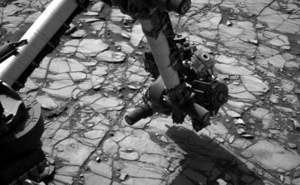 read the article 'Curiosity's Arm Over 'Marimba' Target on Mount Sharp'
