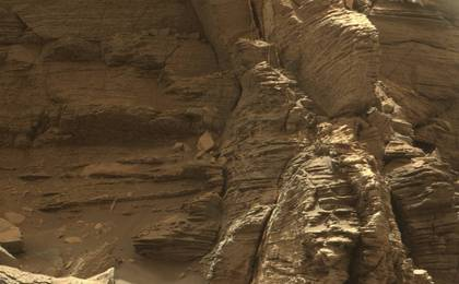 read the article 'Mars Rover Views Spectacular Layered Rock Formations'