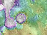 "Valleys much younger than well-known ancient valley networks on Mars are evident near the informally named ""Heart Lake"" on Mars. This map presents color-coded topographical information overlaid onto a photo mosaic. Lower elevations are indicated with white and purple; higher elevations, yellow."