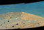 see the image ''Spirit Mound' at Edge of Endeavour Crater, Mars (Enhanced Color)'
