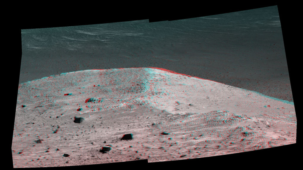 "This stereo scene from NASA's Mars Exploration Rover Opportunity shows ""Spirit Mound"" overlooking the floor of Endeavour Crater. The view appears three-dimensional when seen through blue-red glasses with the red lens on the left."
