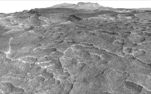This vertically exaggerated view shows scalloped depressions in a part of Mars where such textures prompted researchers to check for buried ice, using ground-penetrating radar aboard NASA's Mars Reconnaissance Orbiter. They found about as much frozen water as the volume of Lake Superior.