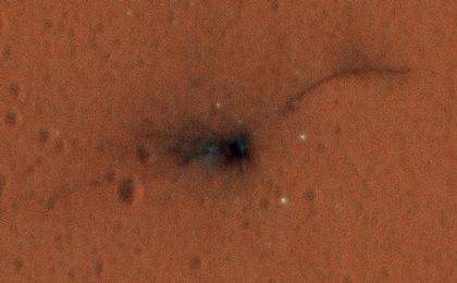 read the article 'Schiaparelli Impact Site on Mars, in Color'