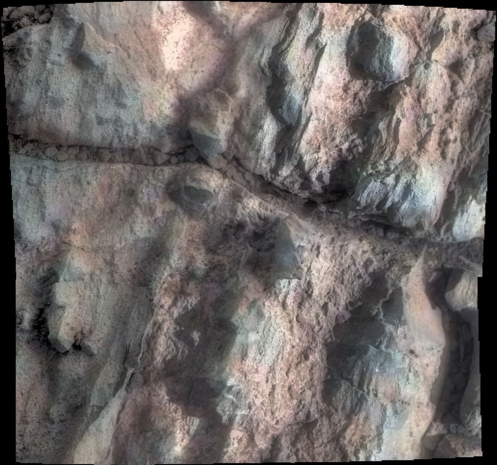 "This rock, dubbed ""Gasconade,"" was investigated by NASA's Mars Exploration Rover Opportunity while the rover was perched on ""Spirit Mound"" at the western edge of Mars' Endeavour Crater. Four Oct. 2, 2016, frames from Opportunity's microscopic imager are joined in this mosaic view."