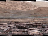 The foreground of this scene from the Mastcam on NASA's Curiosity Mars rover shows purple-hued rocks near the rover's late-2016 location. The middle distance includes future destinations for the rover. Variations in color of the rocks hint at the diversity of their composition on lower Mount Sharp.
