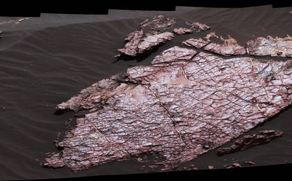 read the article 'Mars Rover's Mastcam View of Possible Mud Cracks'