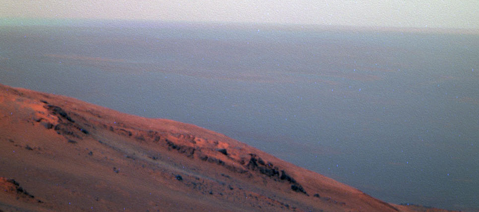 This false-color scene from the panoramic camera (Pancam) on NASA's Mars Exploration Rover Opportunity documents movement of dust as a regional dust storm approached the rover's location on Feb. 24, 2017, during the 4,653rd Martian day, or sol, of the rover's work on Mars.
