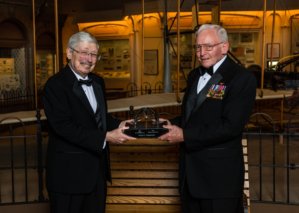 "The 2017 National Air and Space Museum Trophy for Lifetime Achievement was handed to Peter Theisinger, left, by Gen. J.R. ""Jack"" Dailey, the museum's director, on March 29. At NASA's Jet Propulsion Laboratory, Theisinger worked on missions to six planets and led projects that put three rovers on Mars."
