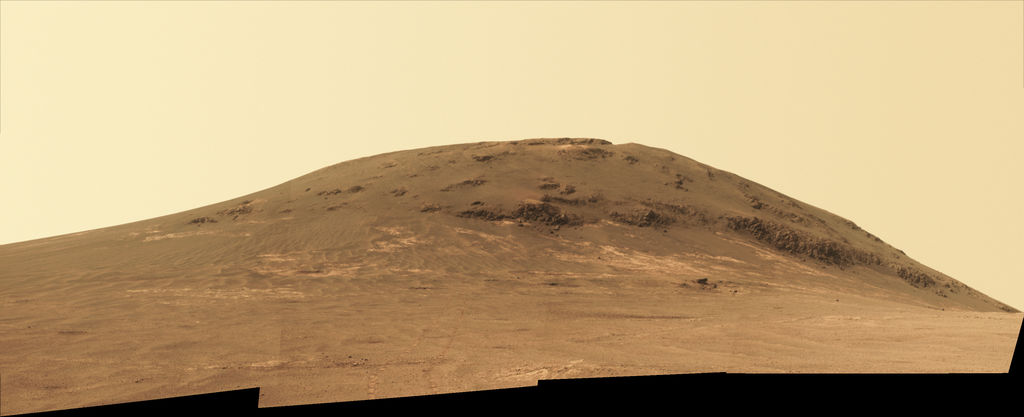 "Wheel tracks from NASA's Mars rover Opportunity descending and departing the ""Cape Tribulation"" segment of Endeavour Crater's rim are visible in this April 21, 2017, view from the rover's Panoramic Camera (Pancam). The rover looked back northward during its trek south to ""Perseverance Valley."""