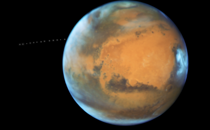 read the article 'NASA's Hubble Sees Martian Moon Orbiting the Red Planet'