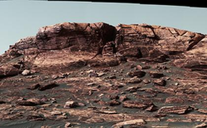read the article 'Martian Ridge Looming Above Curiosity Prior to Ascent'