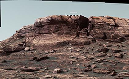 read the article 'Martian Ridge Looming Above Curiosity Prior to Ascent - Figure 1'