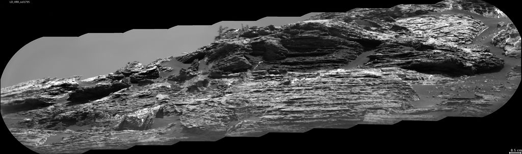 "This view of ""Vera Rubin Ridge"" from the ChemCam instrument on NASA's Curiosity Mars rover shows sedimentary layers, mineral veins and effects of wind erosion. ChemCam's telescopic Remote Micro-Imager took the 10 component images of this scene on Aug. 24, 2017, from about 141 feet away."