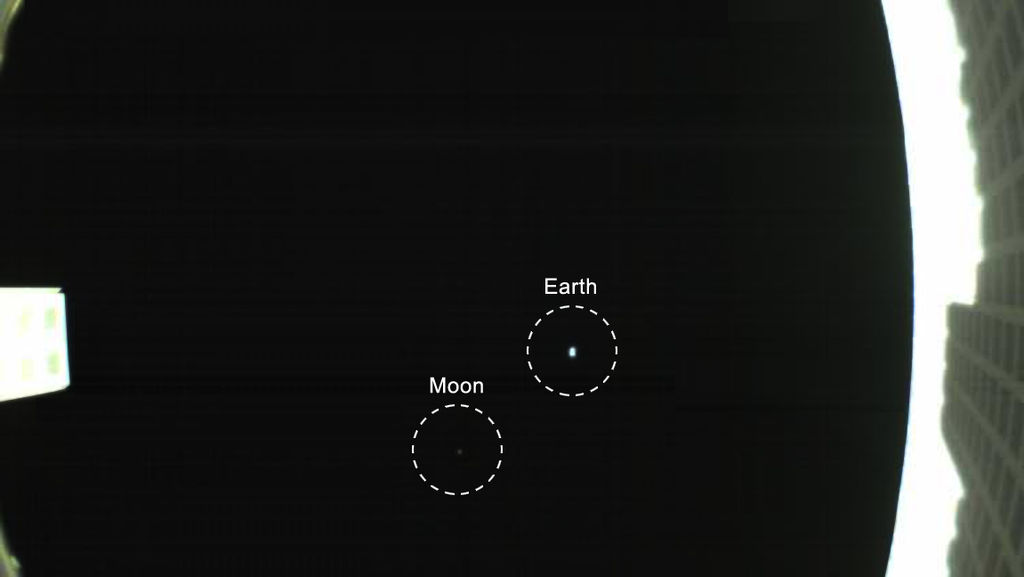 This image taken by NASA's Mars Cube One (MarCO) CubeSats contains a photograph of Earth and Mars at a distance.
