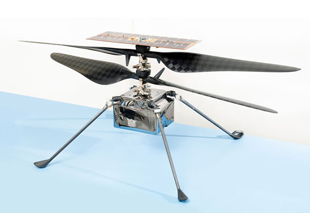 The Mars Helicopter features two pairs of counter-rotating blades, over a small fuselage box with four thin, outstretched legs.