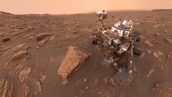A self-portrait of NASA's Curiosity Mars rover shows the robot at a drilled sample site called