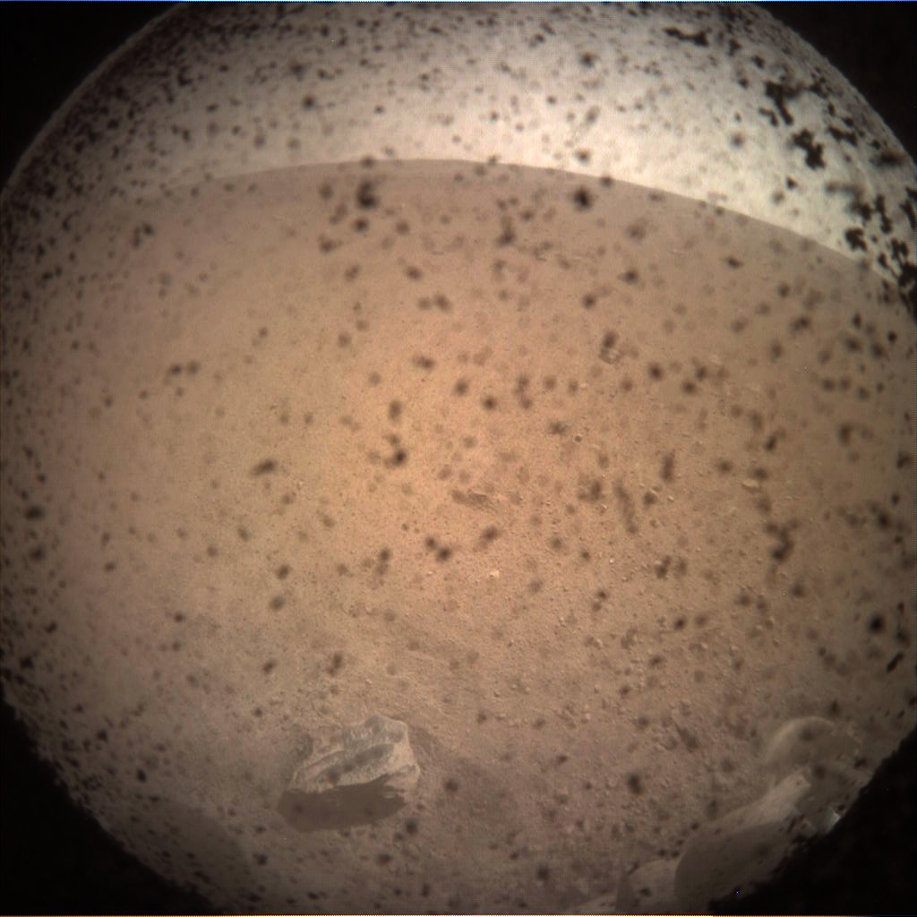 Nasa's Mars lander InSight acquired this image using its Instrument Context Camera on Sol 0
