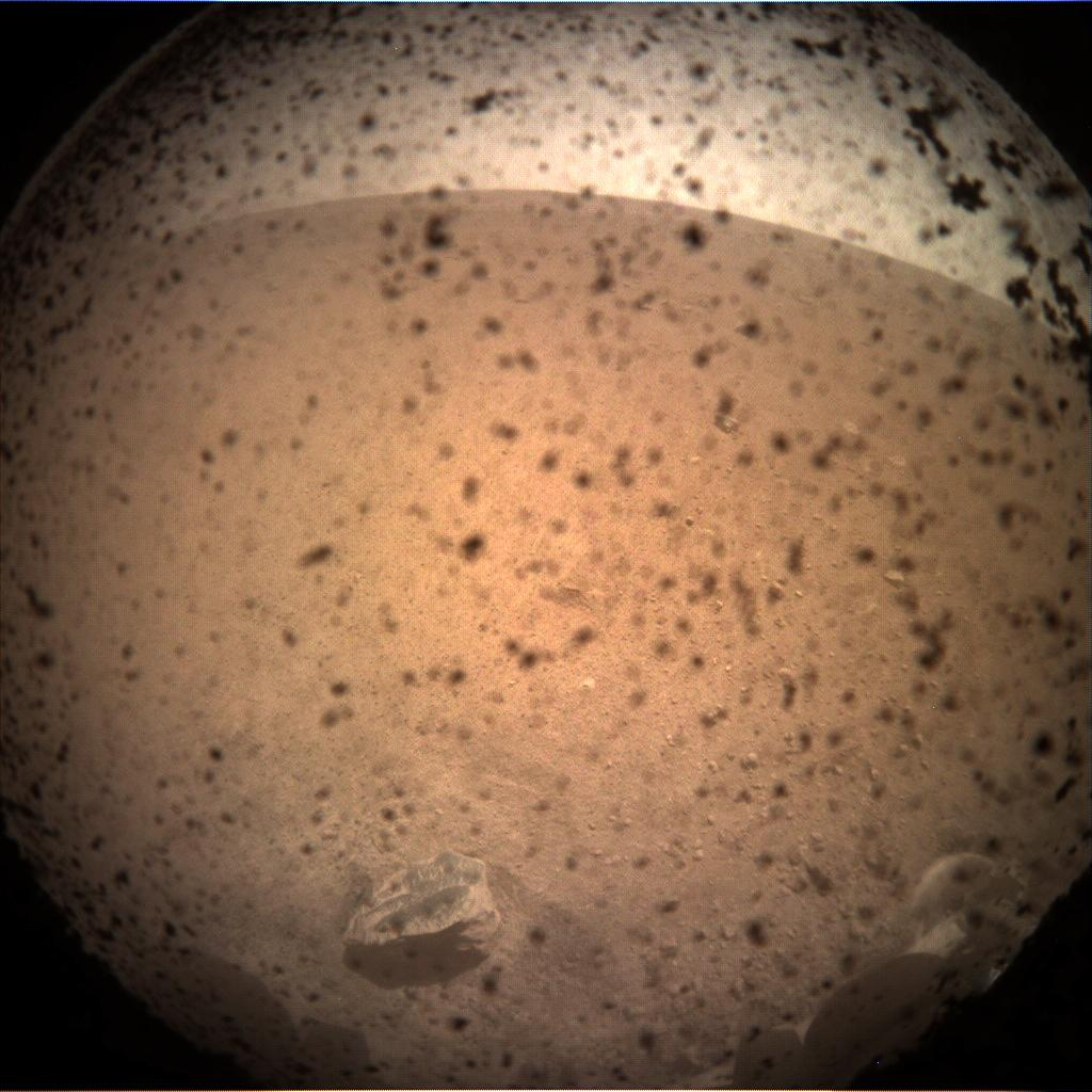 Nasa's Mars lander InSight acquired this image using its Instrument Context Camera on Sol 1