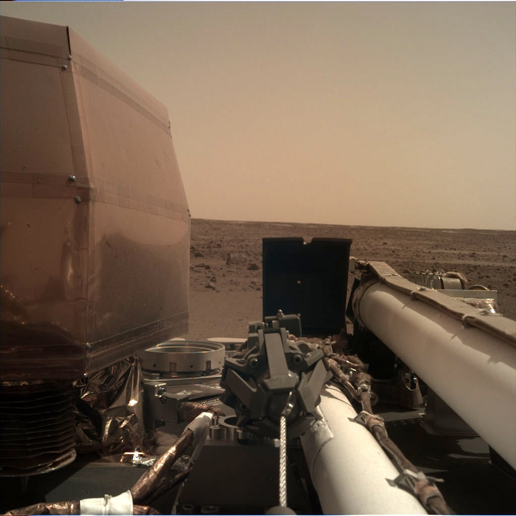 Nasa's Mars lander InSight acquired this image using its Instrument Deployment Camera on Sol 1