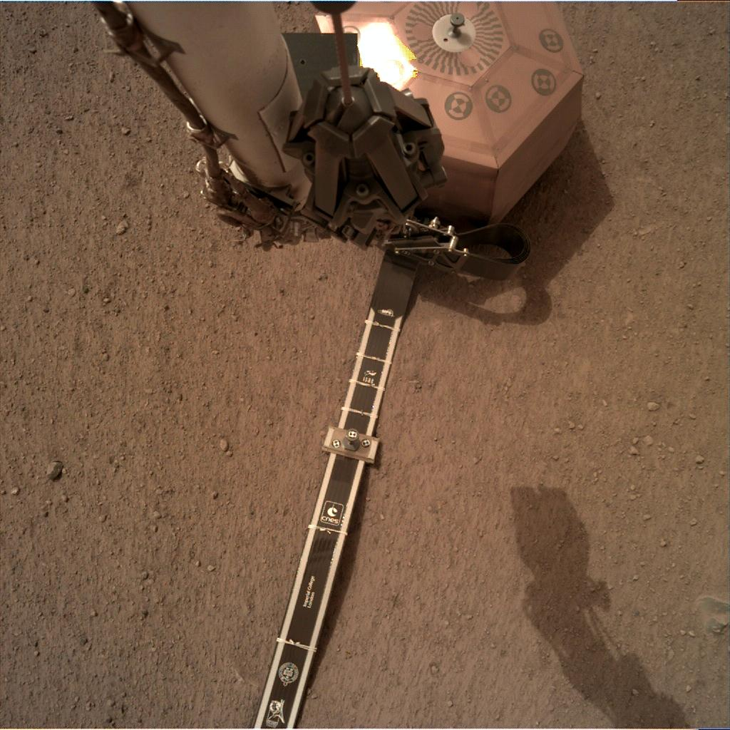 Nasa's Mars lander InSight acquired this image using its Instrument Deployment Camera on Sol 52
