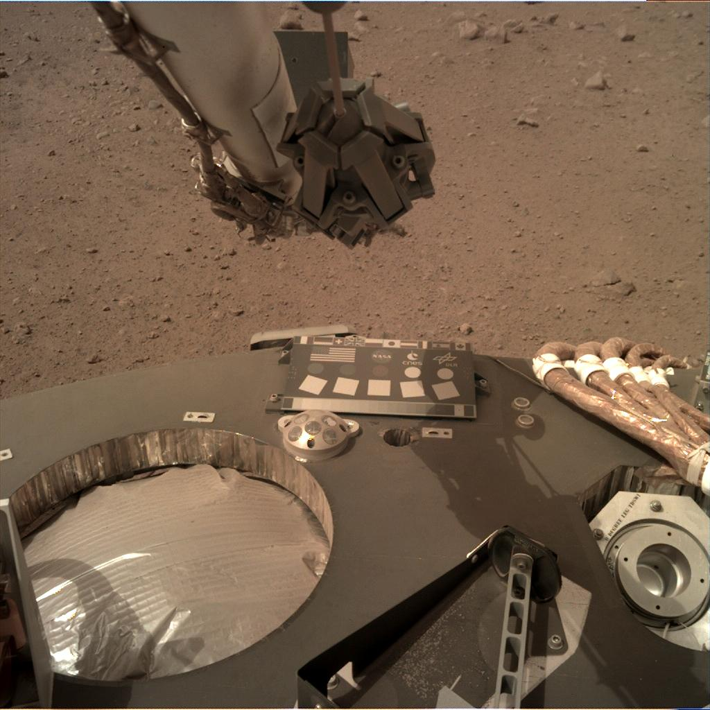 Nasa's Mars lander InSight acquired this image using its Instrument Deployment Camera on Sol 58