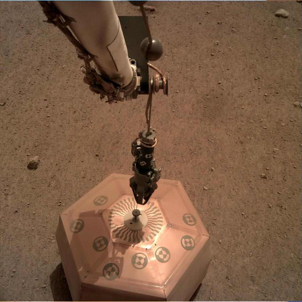 Nasa's Mars lander InSight acquired this image using its Instrument Deployment Camera on Sol 63