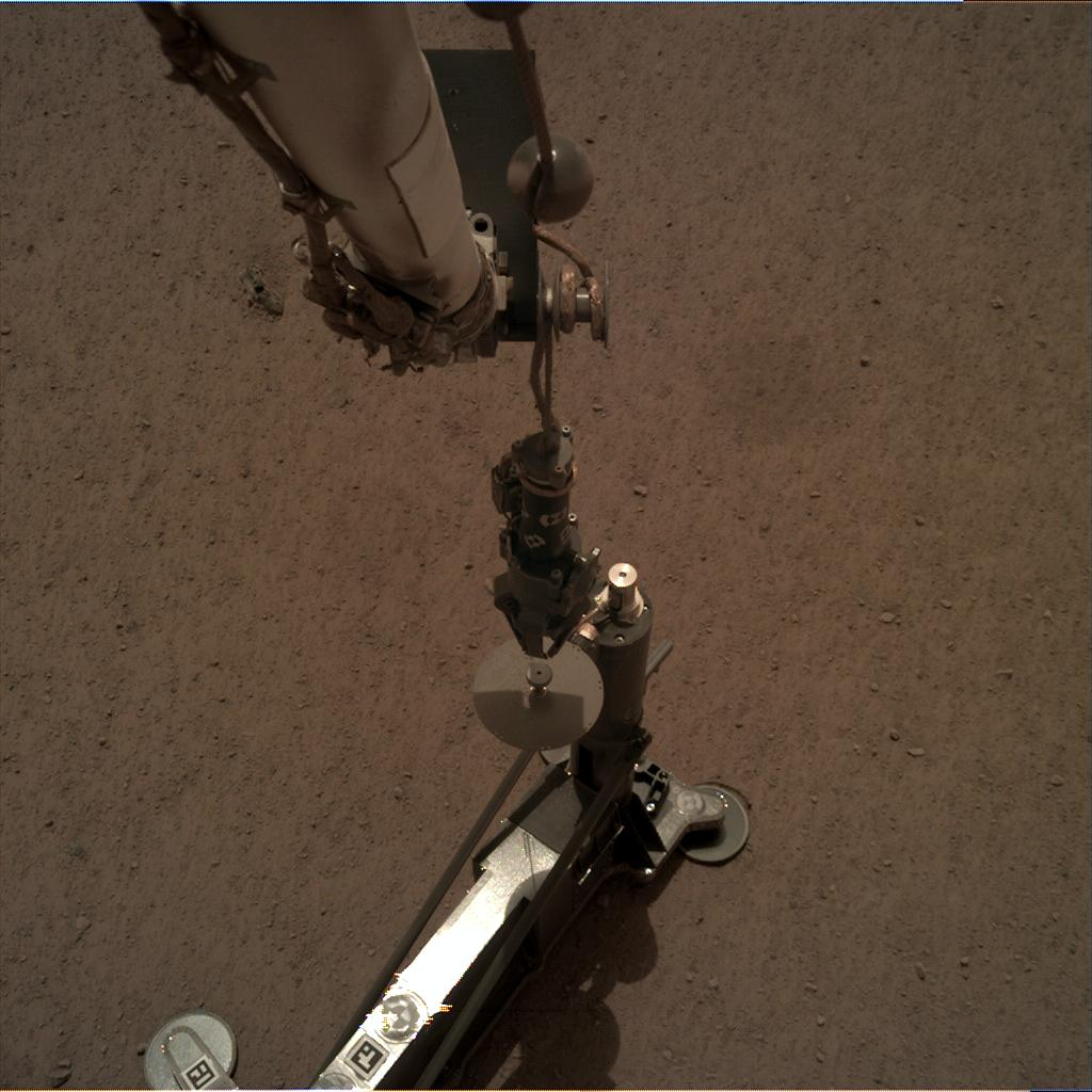 Nasa's Mars lander InSight acquired this image using its Instrument Deployment Camera on Sol 87