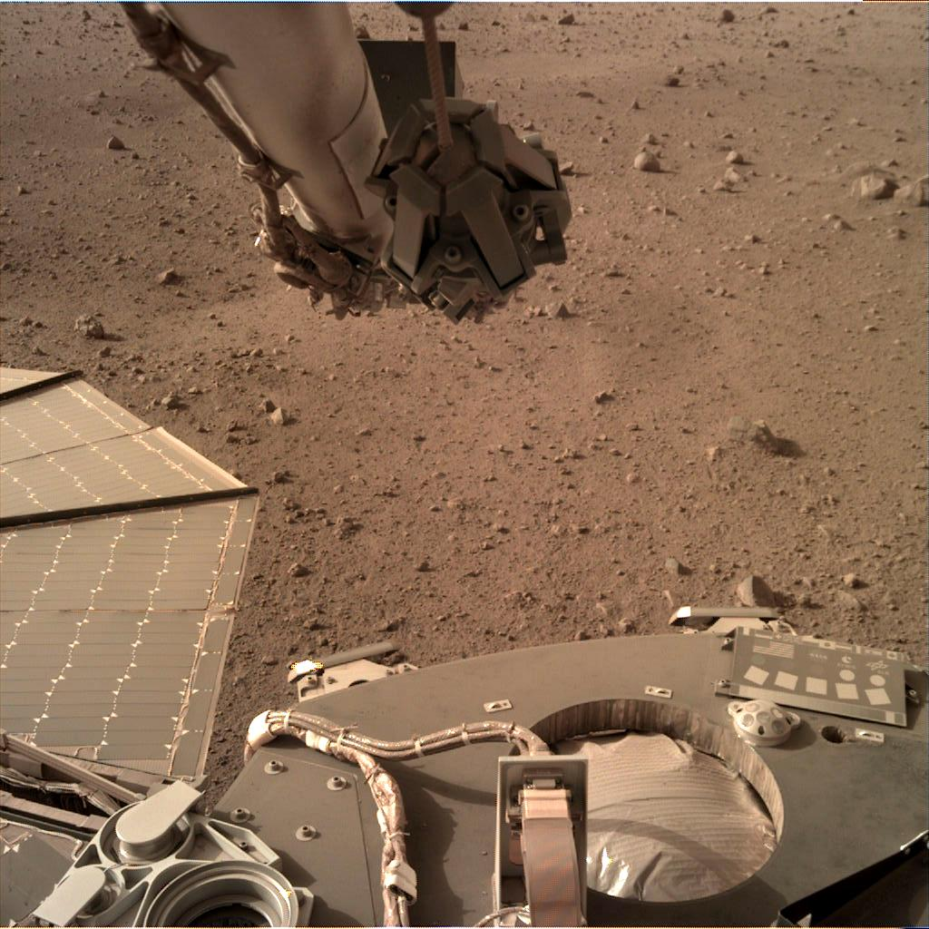 Nasa's Mars lander InSight acquired this image using its Instrument Deployment Camera on Sol 99