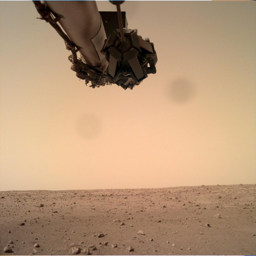 Nasa's Mars lander InSight acquired this image using its Instrument Deployment Camera on Sol 100