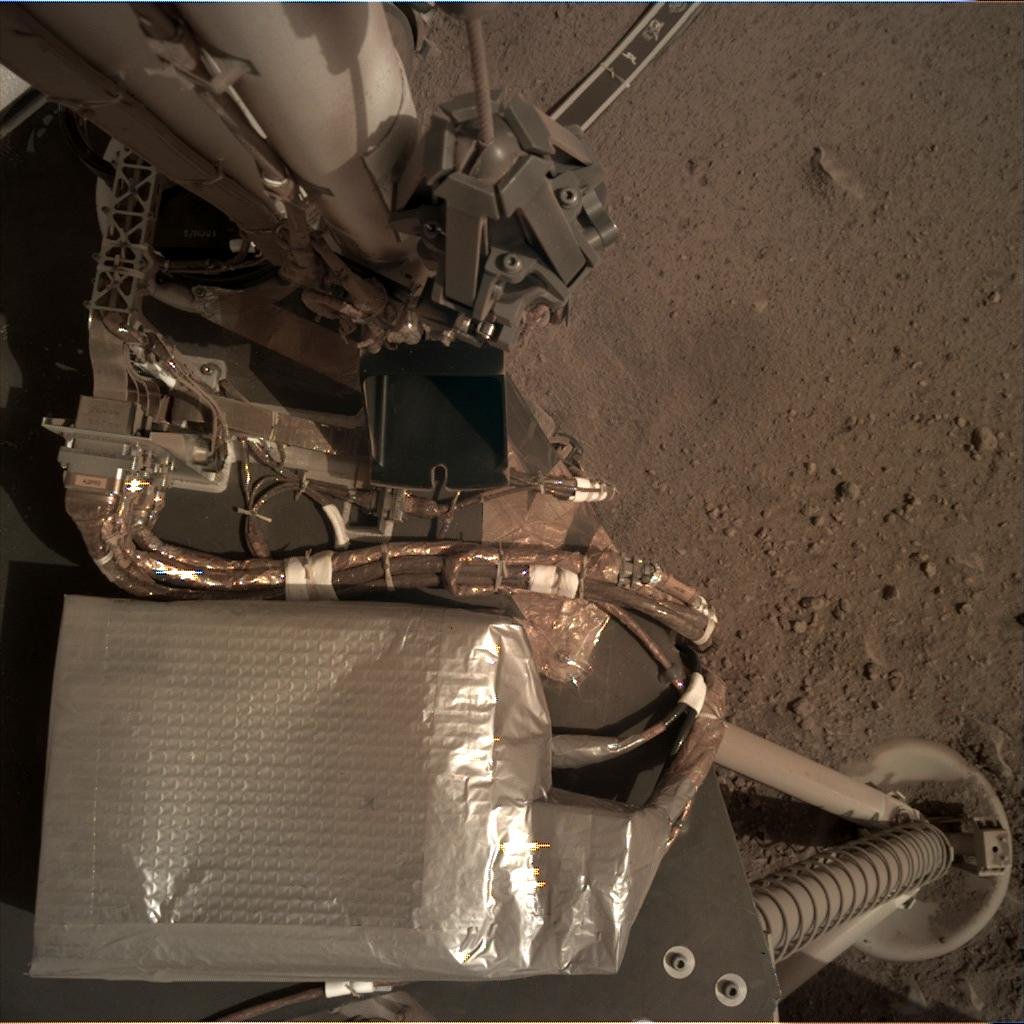 Nasa's Mars lander InSight acquired this image using its Instrument Deployment Camera on Sol 106