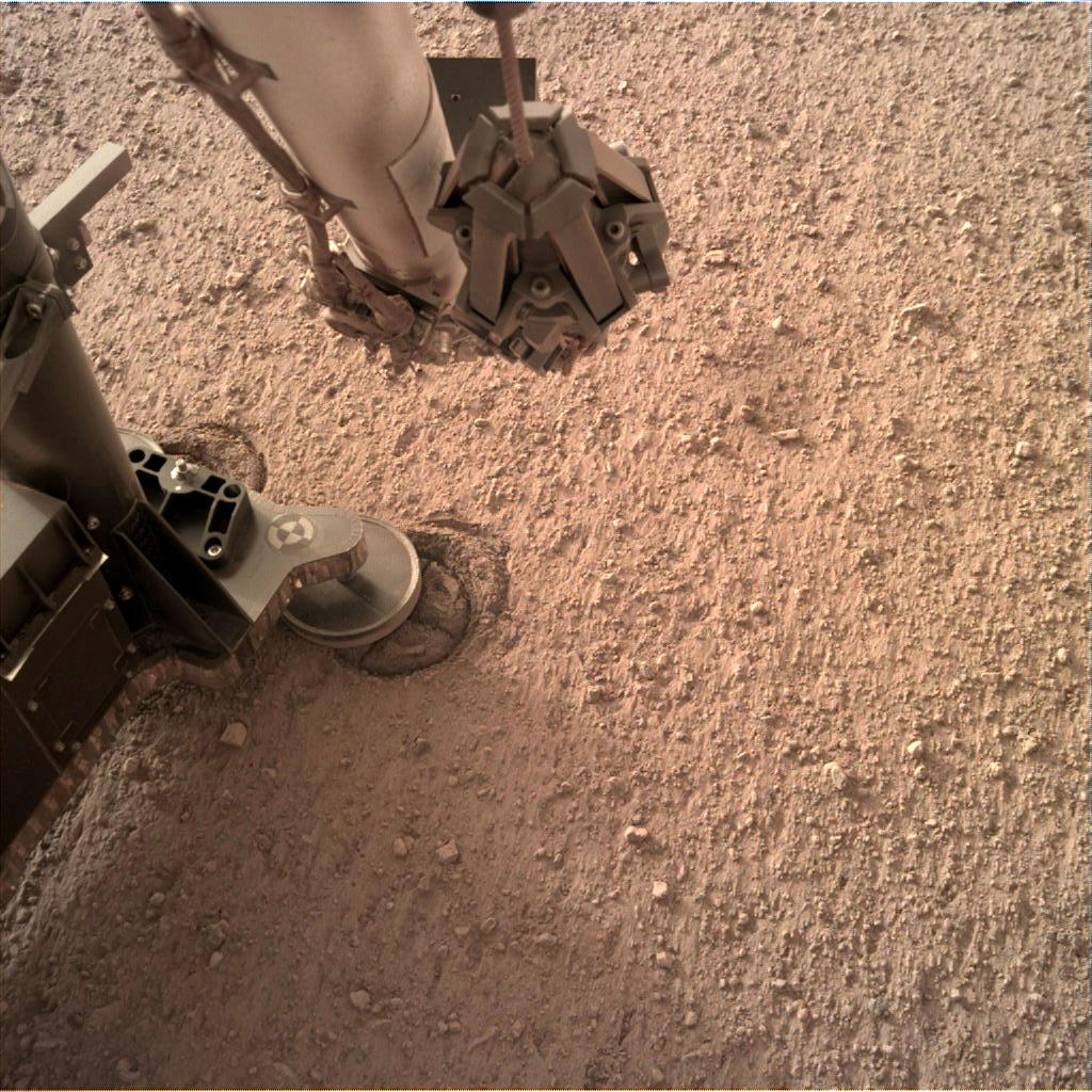 Nasa's Mars lander InSight acquired this image using its Instrument Deployment Camera on Sol 107