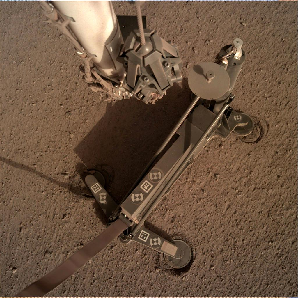 Nasa's Mars lander InSight acquired this image using its Instrument Deployment Camera on Sol 118