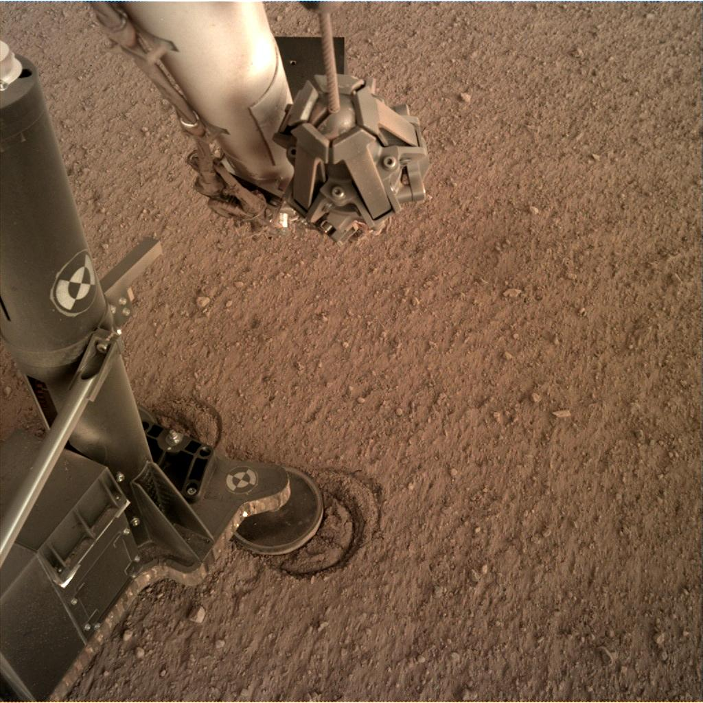 Nasa's Mars lander InSight acquired this image using its Instrument Deployment Camera on Sol 127