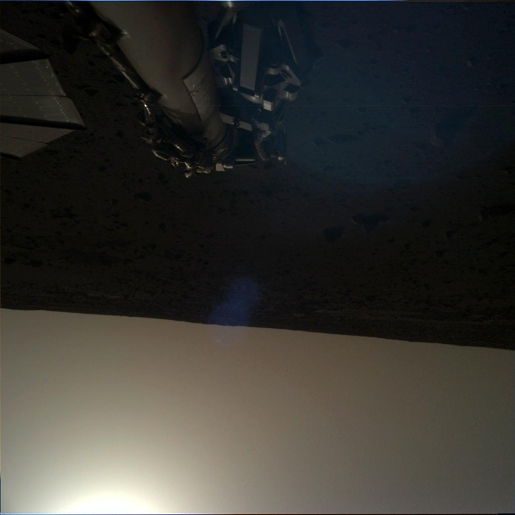 Nasa's Mars lander InSight acquired this image using its Instrument Deployment Camera on Sol 135