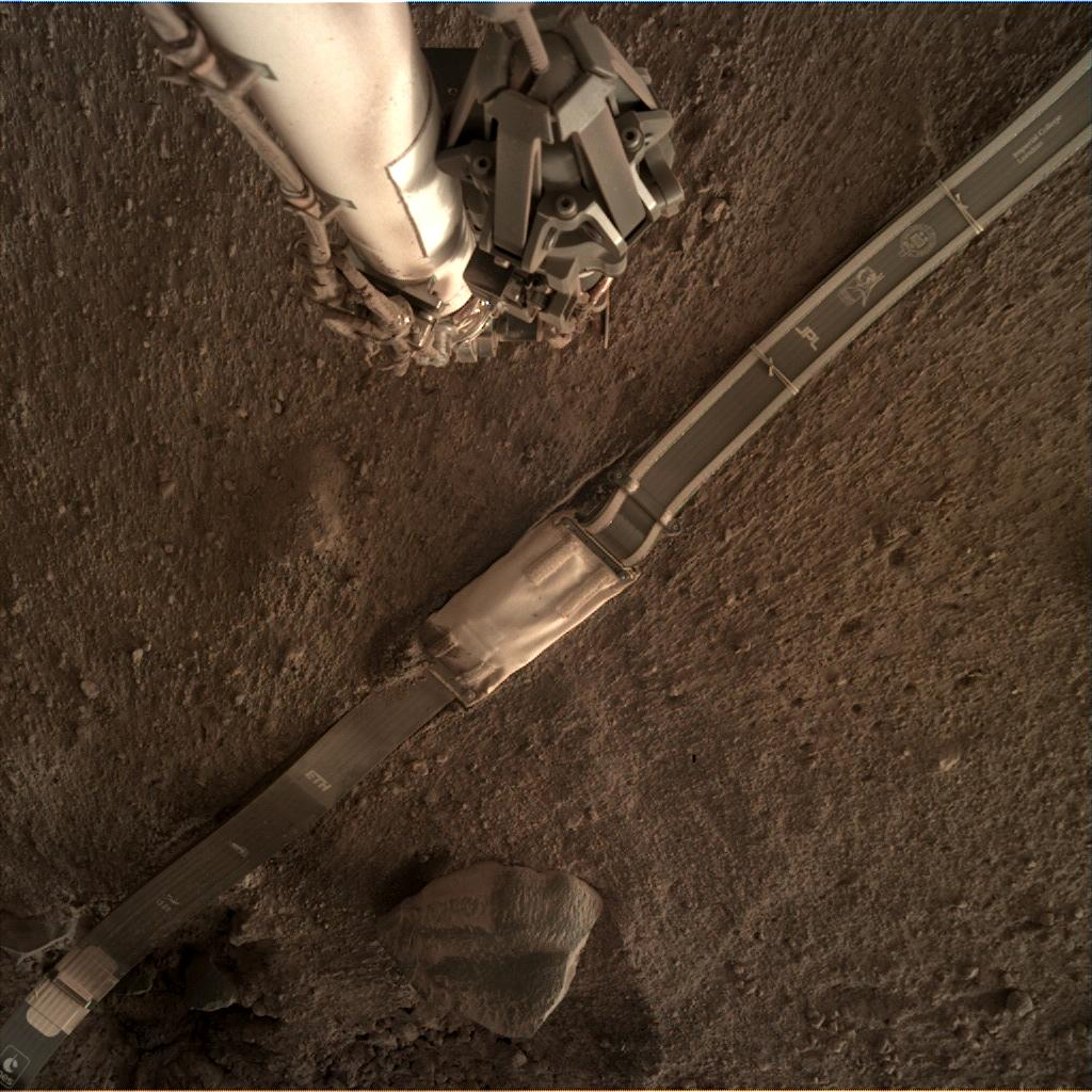 Nasa's Mars lander InSight acquired this image using its Instrument Deployment Camera on Sol 136