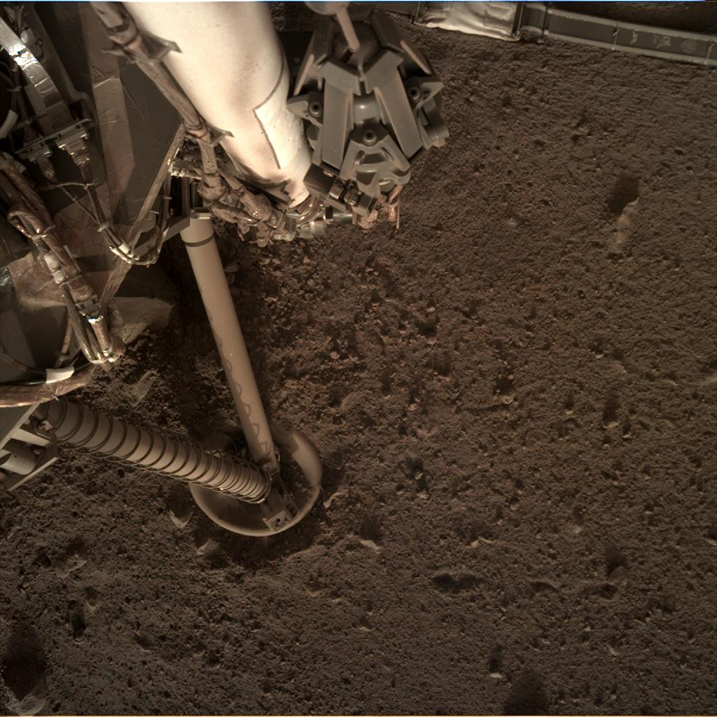Nasa's Mars lander InSight acquired this image using its Instrument Deployment Camera on Sol 137