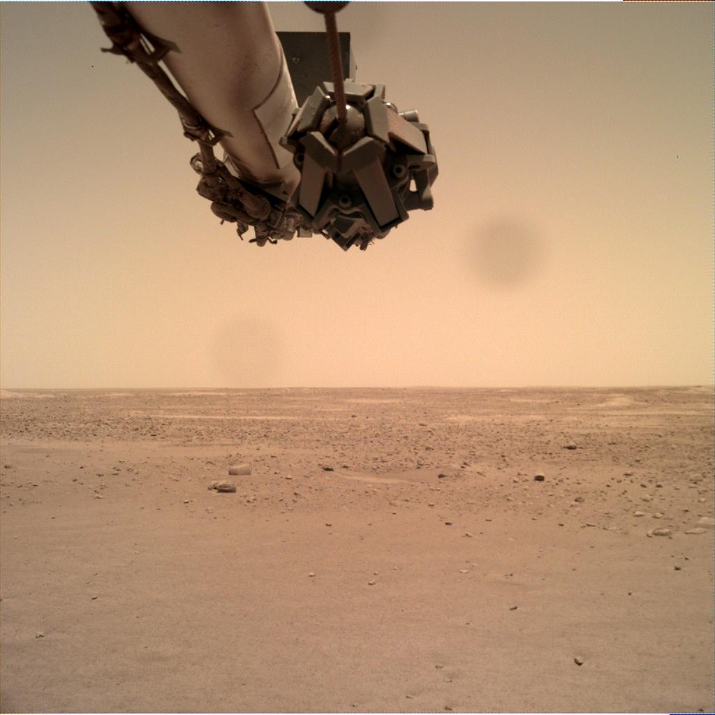 Nasa's Mars lander InSight acquired this image using its Instrument Deployment Camera on Sol 140