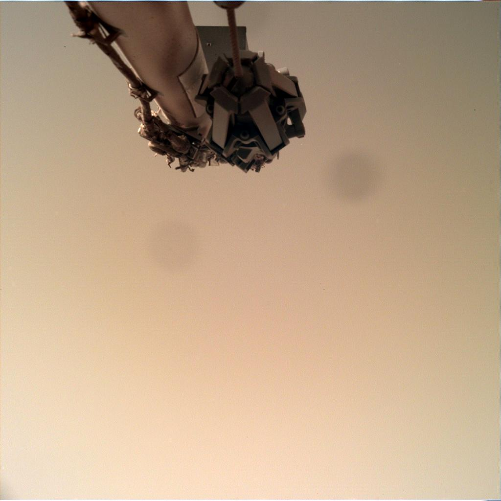 Nasa's Mars lander InSight acquired this image using its Instrument Deployment Camera on Sol 142