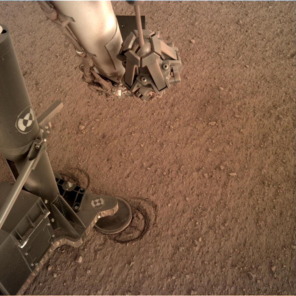 Nasa's Mars lander InSight acquired this image using its Instrument Deployment Camera on Sol 146