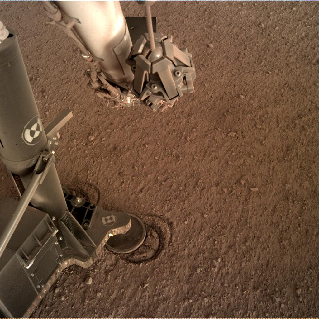 Nasa's Mars lander InSight acquired this image using its Instrument Deployment Camera on Sol 158