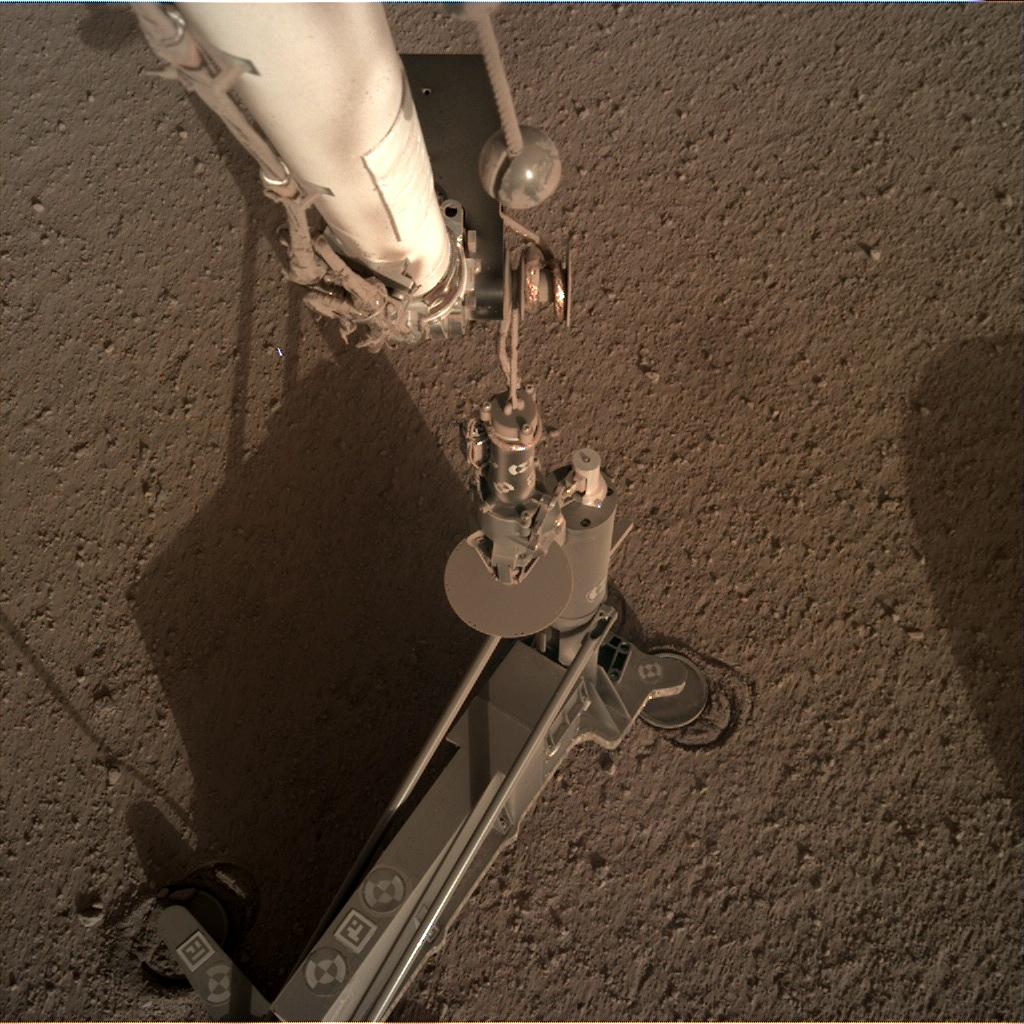 Nasa's Mars lander InSight acquired this image using its Instrument Deployment Camera on Sol 199