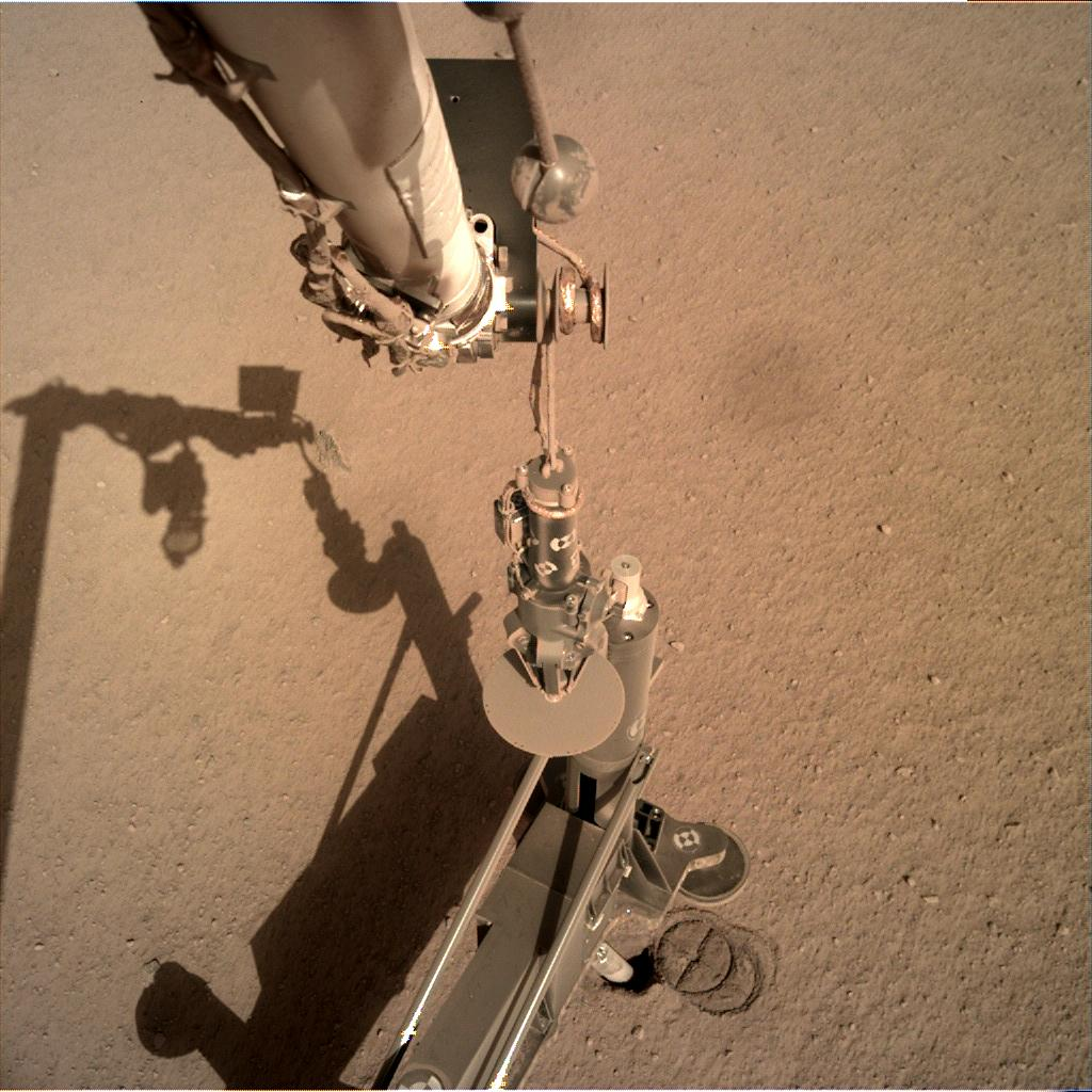 Nasa's Mars lander InSight acquired this image using its Instrument Deployment Camera on Sol 206
