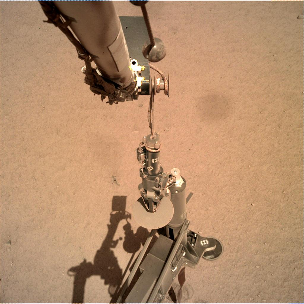 Nasa's Mars lander InSight acquired this image using its Instrument Deployment Camera on Sol 209